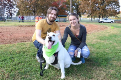 Rowdy, a 3-year-old German Shepherd and Husky mix, wins third place for tallest dog and celebrates with a photo with owners Brittney Elser and Logan Lee at Bark in the Park in Tullahoma, Tenn. on Nov. 4, 2017. (Victoria Leuang / MTSU Sidelines)