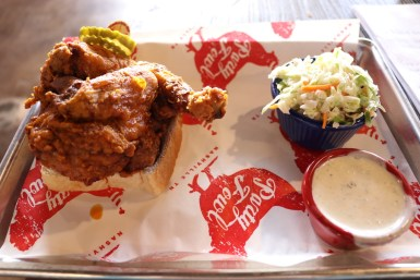 The traditional Hot Chicken is a half bird served on Texas toast with dill pickles and cole slaw, and it can be found at Party Fowl in Murfreesboro, Tenn. starting Dec. 26, 2017. (Victoria Leuang / MTSU Sidelines)