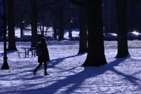 A student walks through walnut grove as the sun begins to melt the snow on Jan. 18, 2018, in Murfreesboro, Tenn. (Andrew Wigdor / MTSU Sidelines)