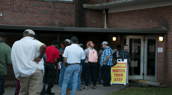 Students and Murfreesboro residents line up outside the voting polls.