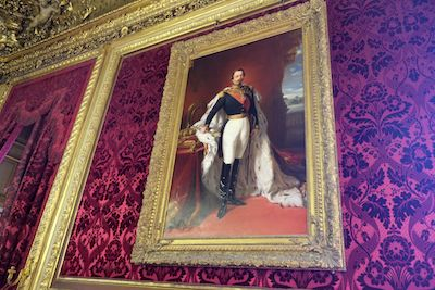 Napoleon III's portrait hangs in his luxurious apartment in the Louvre.