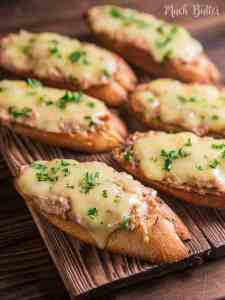 Tuna melt bruschetta is easy and delicious Italian inspired appetizer and snack. Cheesy, creamy and savory tuna topped baguette.
