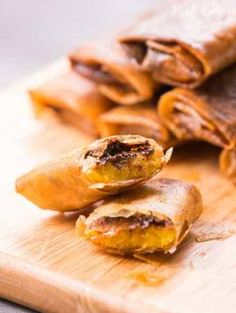 Chocolate banana spring rolls are simple and easy dessert. It only needs three ingredients. The outer texture is crunchy and the inside is soft warm banana and melty chocolate.