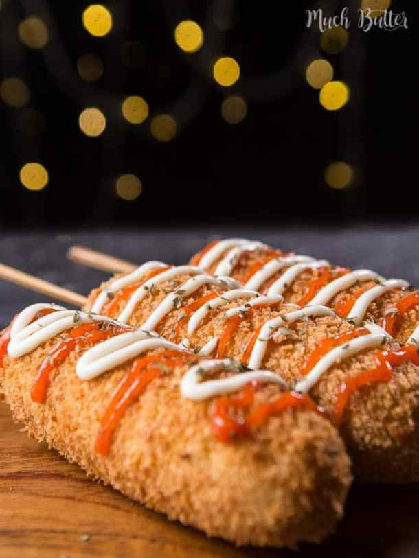 Corn dog is a sausage on a stick that coated in a thick layer of batter and breadcrumbs. It is great for appetizer and afternoon snacks.