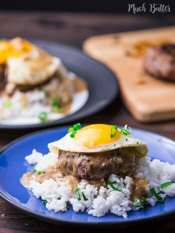 Loco moco is a Hawaiian cuisine made with white rice topped with a hamburger patty, sunny side up egg, and brown beef gravy.