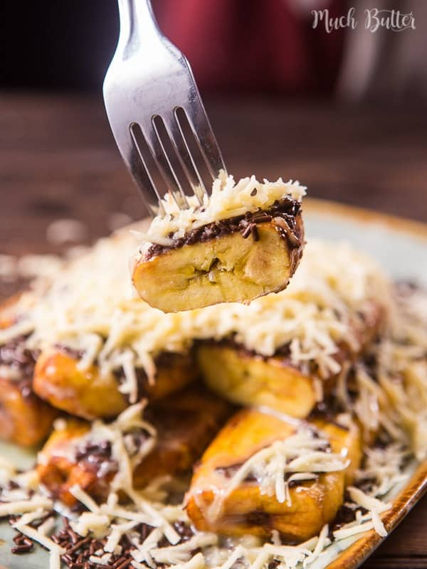 Chocolate cheese fried yellow plantain is an Indonesia dessert/snack. It's topped with chocolate sprinkles, shredded cheddar cheese, and sweetened condensed milk. The sweet and legit taste is very popular among Indonesian people.