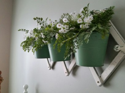 I found this at a local florist - It was the perfect green for the room - I put the daisies and the greenery in the buckets.