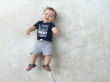 cutest baby in yankees gear and gap and freshly picked moccasins
