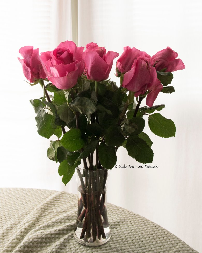 Boquet of pink roses in vase on table | The Last Thing I Expected To Receive on Valentine's Day via muddybootsanddiamonds.com