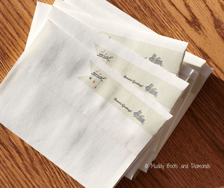 Stack of Greeting Cards with Seasons Greeting Label via Muddy Boots and Diamonds blog