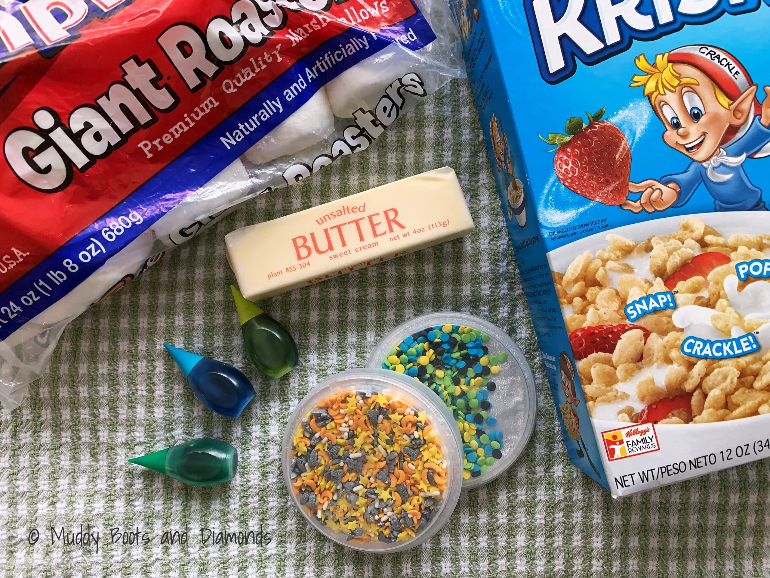 Flat Lay of Rice Krispie Treat Ingredients cereal butter marshmallows butter food coloring sprinkles