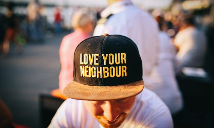Man wearing hat that says Love Your Neighbor