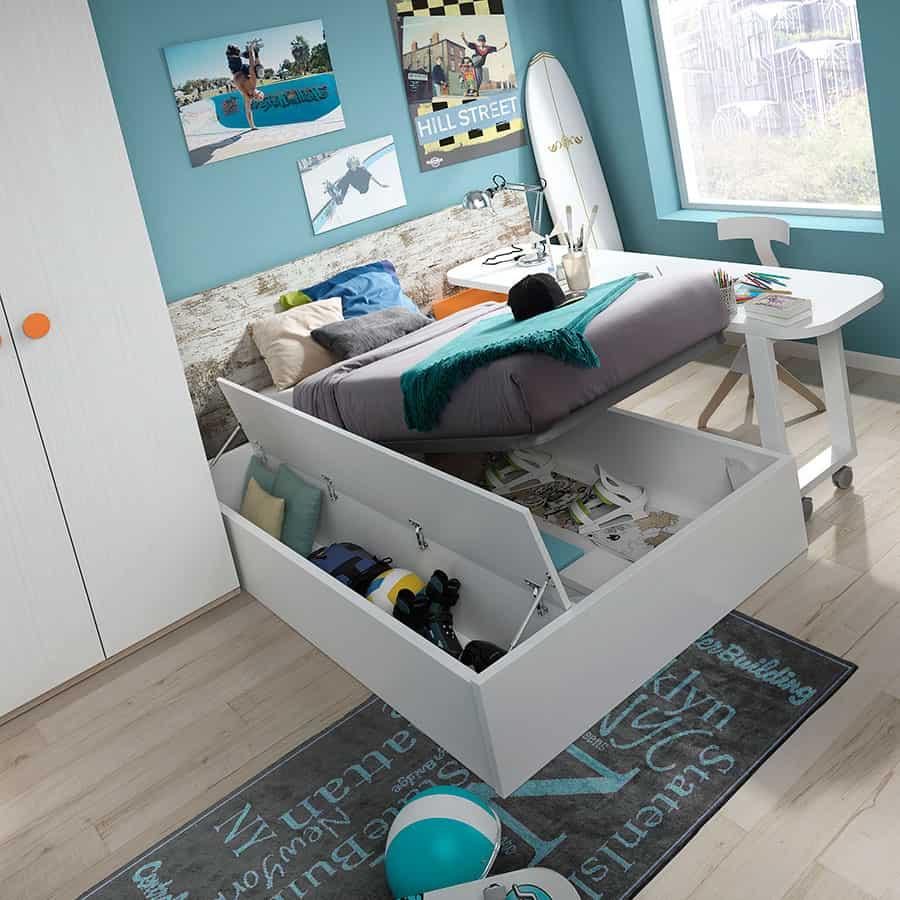 Habitación juvenil con cama con cajonera abierta