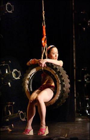 SITI member Akiko Aizawa swings through bobrauschenbergamerica. Photo: Michael Brosilow.