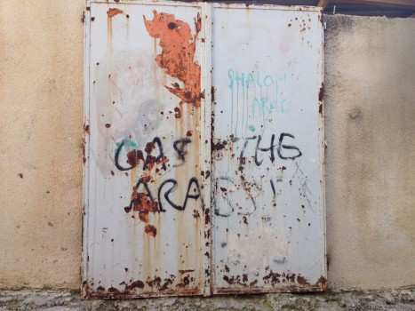 Graffiti on door in Tel Rumedia [Photo: EAPPI/Sabrina Tucci]