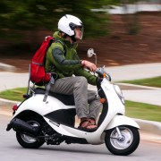 Two Friends on Moped Make Immense Effort to Not Touch Each Other
