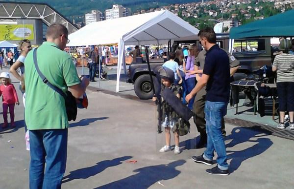 Kids Fest 2013 EUFOR/NATO Kid wearing riot control equipment