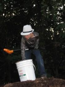 Putting mulch into buckets