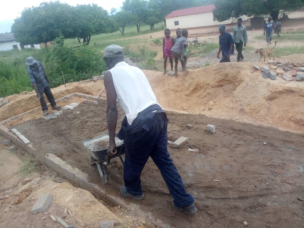 Volunteers building ablution facilities