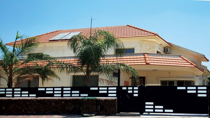 Black aluminum and glass driveway gate