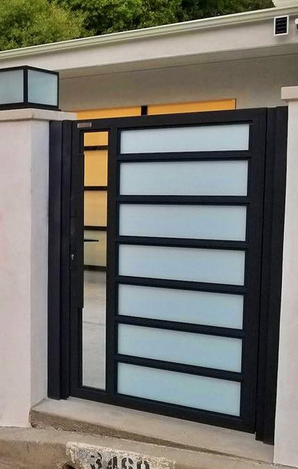White aluminum and glass driveway gate