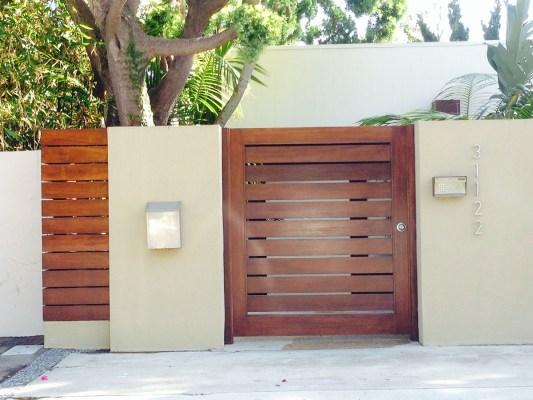 Horizontal slated wood entry gate with keypad
