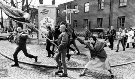 A Woman Hitting a Neo-Nazi With Her Handbag, Danuta Danielsson by Hans Runesson