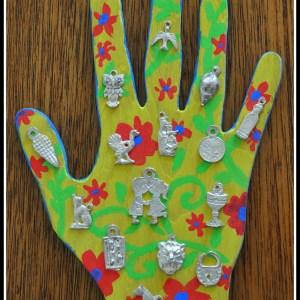 handmade wooden hand from Mexico adorned with Miracle Charms