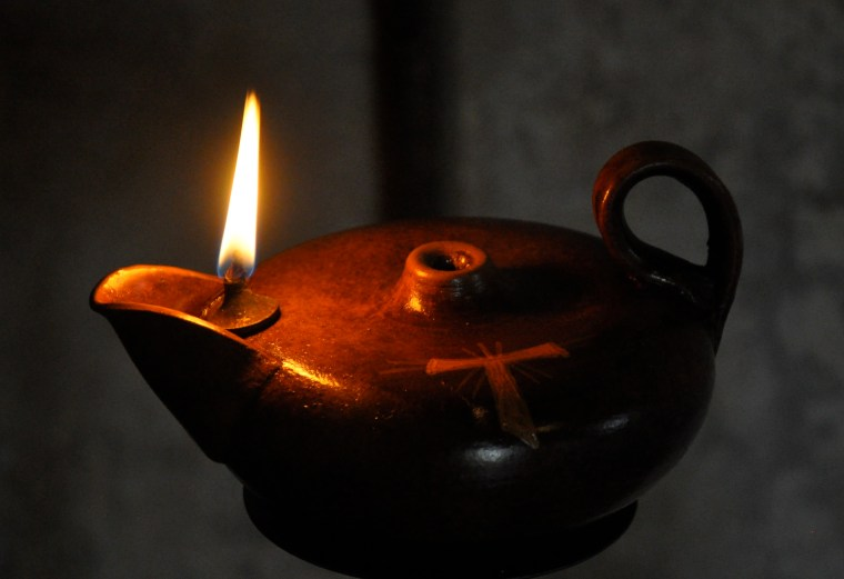 Old style Franciscan Oil Lamp.