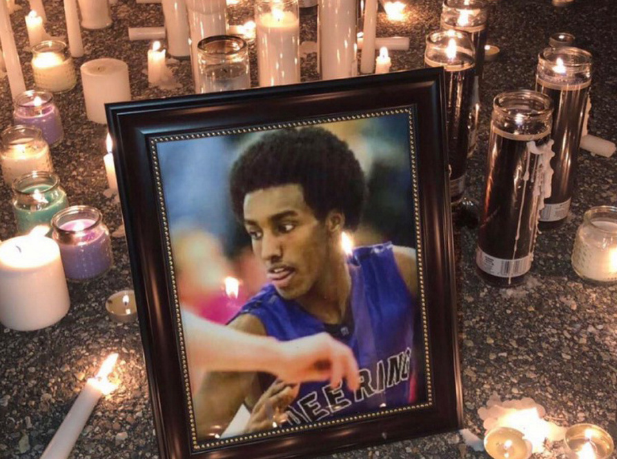 A vigil for Isahak Muse was held in Portland on March 19, three days after he was shot to death during an altercation at 107 Milton St.
