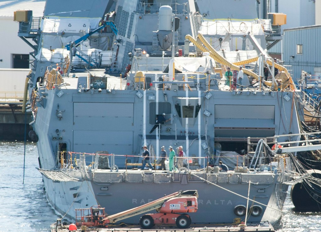 Workers walk across the aft deck of an Arleigh Burke destroyer at Bath Iron Works in 2016. The yard was praised for its workforce development efforts by U.S. Navy Secretary Richard Spencer in a recent congressional committee hearing.
