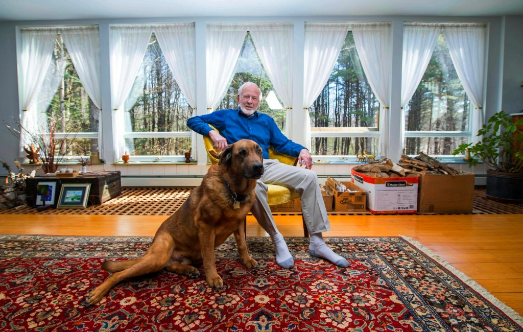 Fred Wiand poses Tuesday with his dog, Baxter, at his home in South China. Wiand has filed papers to run for president of the United States as a Democrat in the 2020 election.