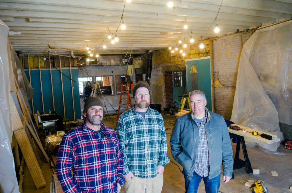 From left, co-owners Matthew Kendall, Steve Sommers and Steve Casey pose on Wednesday in what will become the brew room of Bateau Brewing  in Gardiner.
