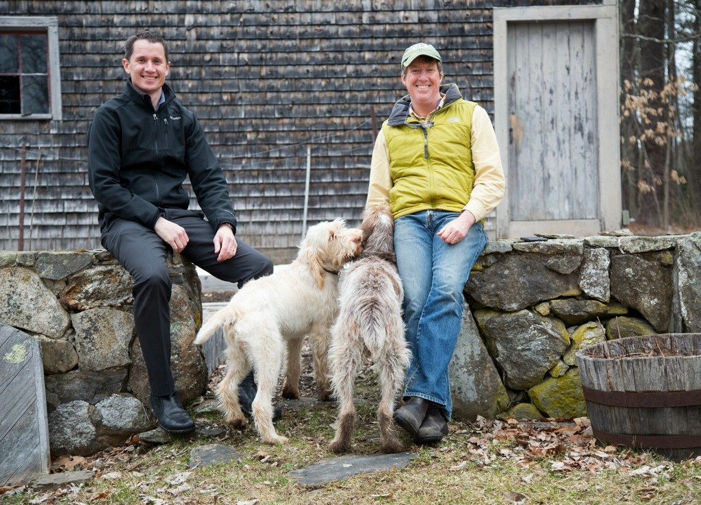 Conservation Law Foundation attorney Phelps Turner, left, and Executive Vice President Sean Mahoney, pictured at Mahoney's Falmouth home with his dogs Lola and Fergus. The Legal Food Hub, winner of a 2019 Source Award, is a program of the Conservation Law Foundation.