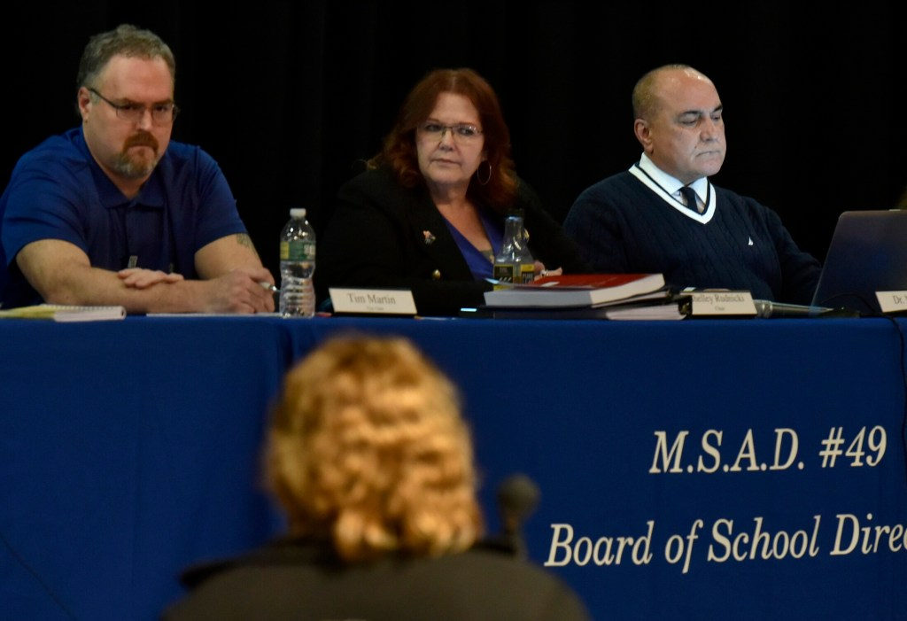 SAD 49 teacher Diana Nutting addresses from left, SAD 49 school board member Tim Martin, chairwoman Shelley Rudnicki and Superintendent Reza Namin during a well attended meeting with students, faculty and parents in Fairfield on Thursday.