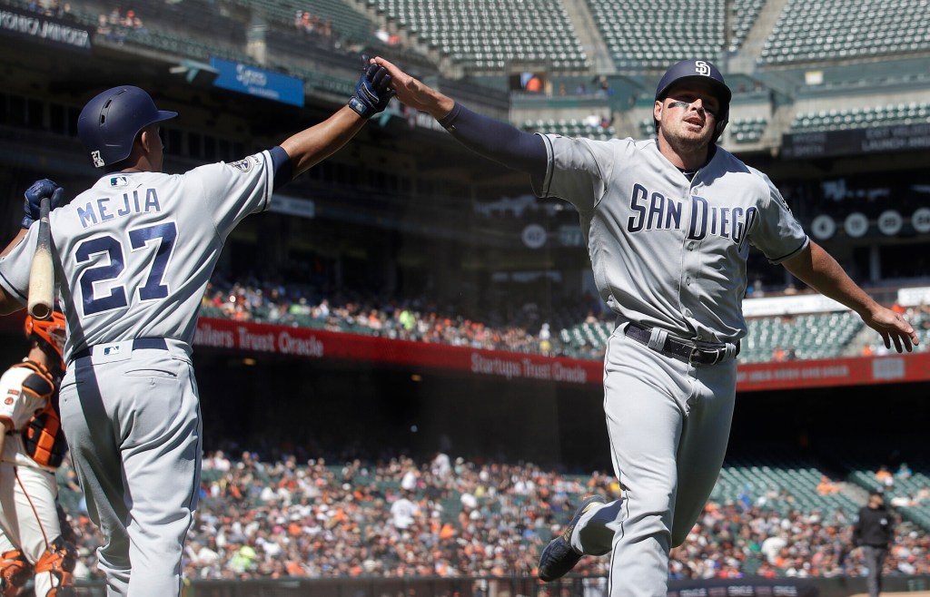 San Diego's Hunter Renfroe, right, is congratulated by Francisco Mejia after scoring a run against the San Francisco Giants in the ninth inning Wednesday.