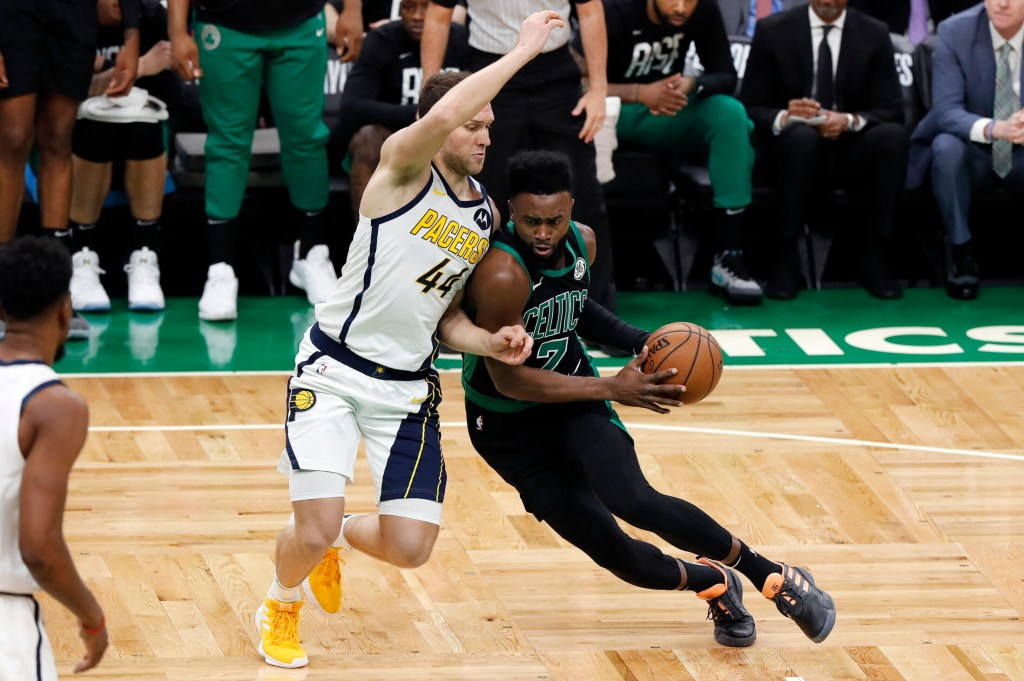 Boston's Jaylen Brown drives on the Pacers' Bojan Bogdanovic Sunday during Game 1 of their first-round playoff series at TD Garden. The Celtics won, 84-74.