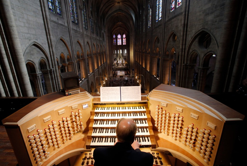 Philippe Lefebvre plays the organ at Notre Dame cathedral in Paris in 2013. The organ didn't burn in the fire, but it isn't yet known whether it was damaged.