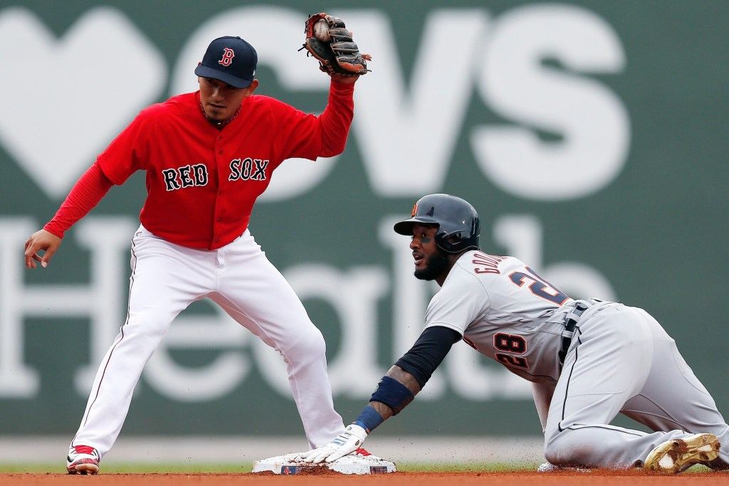 Detroit's Niko Goodrum steals second base while Boston's Tzu-Wei Lin looks for the call on Monday in Boston. The Red Sox lost the first game of the doubleheader, 7-4.