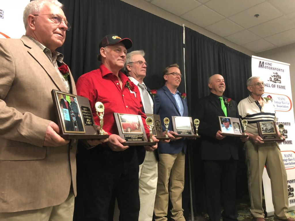 From left to right, Bob Bailey, Dale Chadbourne, Billy Clark, Ricky Craven, Dick Fowler and Lomer Pelletier receive plaques to commemorate their induction into the Maine Motorsports Hall of Fame on Saturday at the Augusta Civic Center in Augusta.