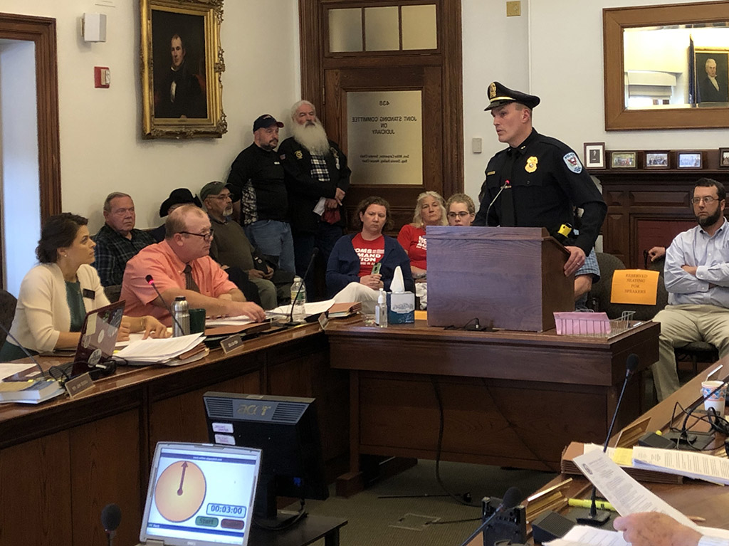 "Ellsworth Police Chief Glenn Moshier testified Monday in support of a ""red flag"" gun bill that would allow police to get court orders to temporarily confiscate firearms from people who may pose a danger to themselves or others."