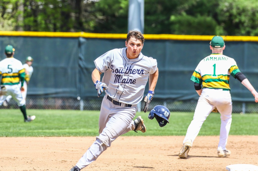 Jake Dexter heads to third in the top of the ninth inning after his hit to right field was misplayed, allowing Andrew Hillier to score. Dexter scored the winning run on a wild pitch as the Huskies beat Oswego State 3-2 to remain alive in the NCAA Division III baseball tournament on Saturday in Gorham.