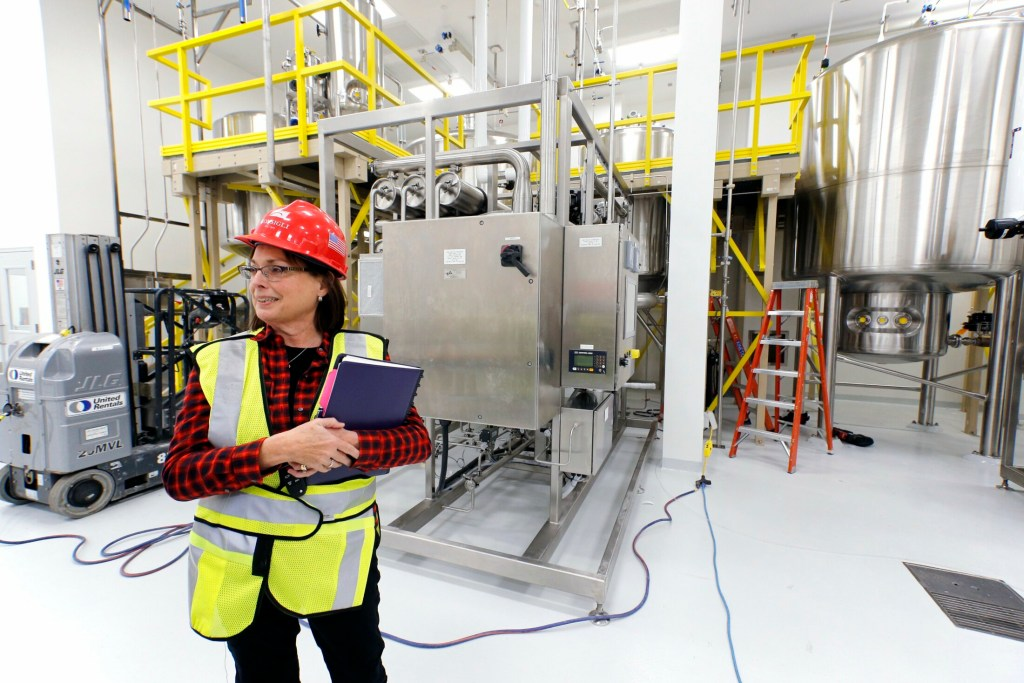 Betsy Williams, vice president of manufacturing operations at ImmuCell, gives a tour of its new facility in the Riverside area of Portland. On Tuesday, the company reported a loss in its second quarter, but is still beating its previous year sales.