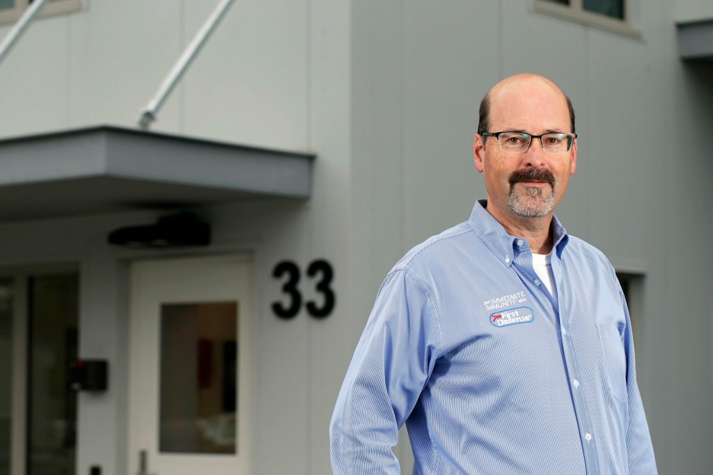 Michael Brigham, president and CEO of ImmuCell, stands outside the company's new building in the Riverside area of Portland. On Tuesday, the company reported strong revenue in its first quarter, attributable to clearing a bottleneck of back orders that had slowed revenues. The company makes bovine medicine for the beef and dairy industries.