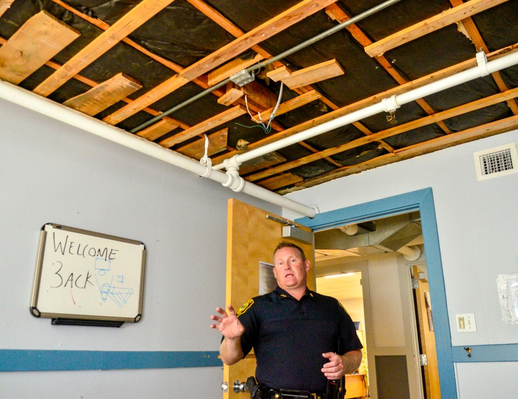 Augusta Police Chief Jared Mills stands in a detective's office, where the ceiling was ripped down after a leak, during a tour of the Augusta Police Station on Aug. 21 in Augusta.