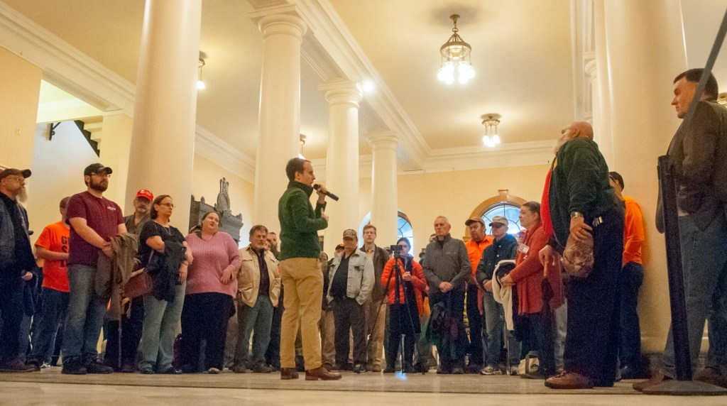 Eric Brakey speaks at a rally in support of gun rights Friday before a day of testimony on gun bills before the Criminal Justice and Public Safety Committee.
