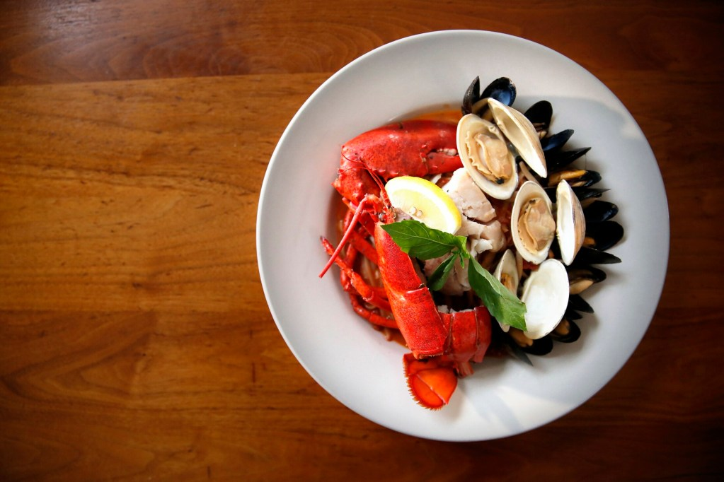 Sicilian-style cioppino –  the house specialty at Azure Cafe – includes half a lobster, countneck clams, pollock and mussels in a spicy tomato broth. It was our reviewer's favorite dish.
