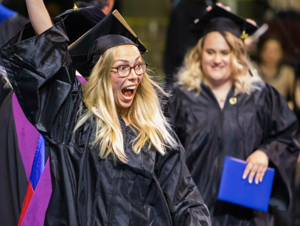 Sabrina Hahn of Germany celebrates after receiving her degree in Early Childhood Education during the Southern Maine Community College commencement Sunday at the Cross Insurance Arena in Portland.