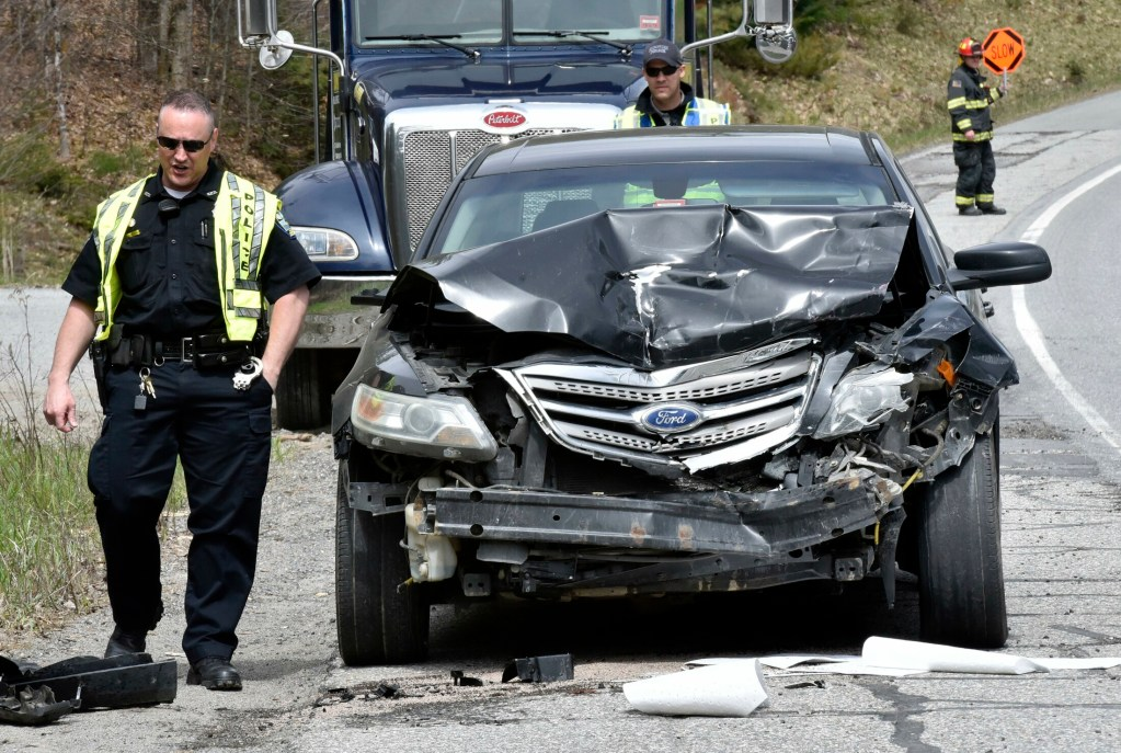 Skowhegan police officers investigate one of two vehicles involved in an accident Monday morning on U.S. Route 201 in Skowhegan. One person was taken to Redington-Fairview Hospital by ambulance.