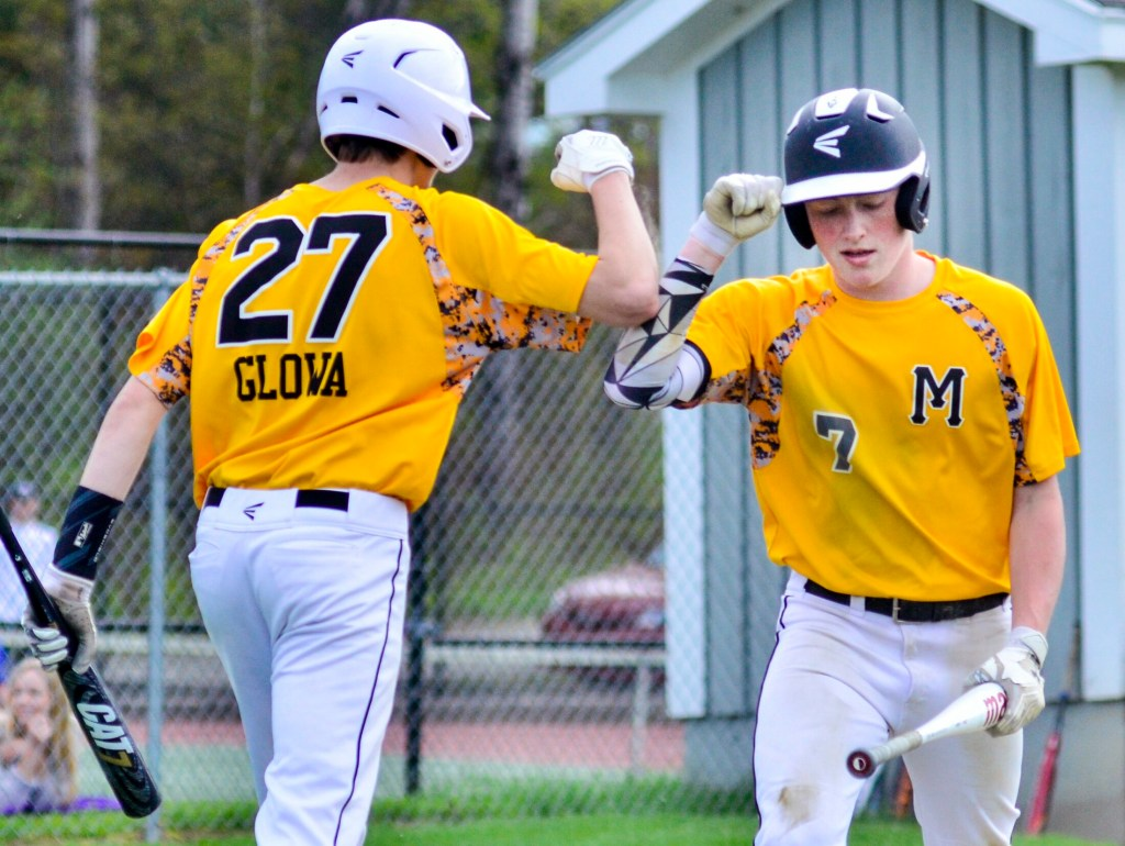 Maranacook's Hunter Glowa celebrates with teammate Duncan Rogers after Rogers scored a run to put the Black Bears up 1-0 in the first inning against Waterville on Wednesday in Readfield.